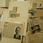 newspaper clippings table (close-up) by carmichaellibrary