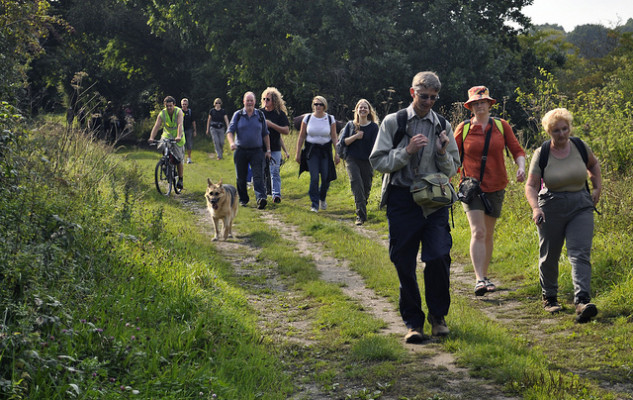 Walkers on old railway Combe Haven Valley - route of proposed bypass by jimkillock